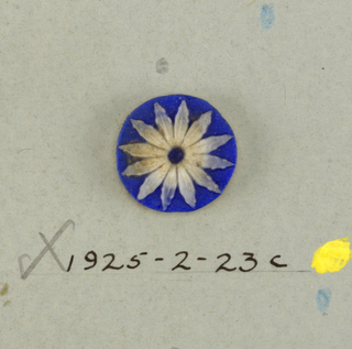 Three circular medallions in the style of Wedgwood Jasperware; open flower with twelve crinkled petals; white on blue.