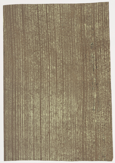 Rough textured paper, pale green and black streaks on brown ground. Resembles moss-streaked bark of tree.