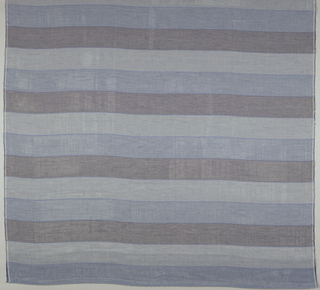 Sheer fabric with vertical stripes of double weave in shades of blue and grey