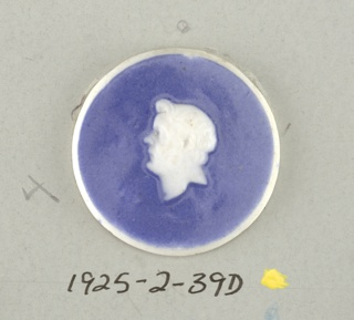 Six circular medallions in the style of Wedgwood Jasperware; each ornamented with a head drawn in the Classic manner; white on blue ground.