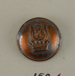 Convex button in the design of a crown on which is a crowned lion sitting between crowns. Back and shank are brass.  On card E