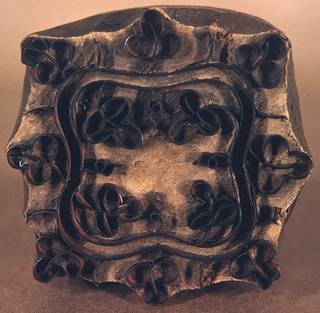 One of twenty-one wood blocks showing a different floral motif formed by metal strips set in wood.