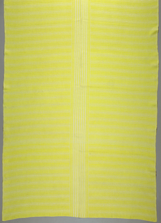 Tablecloth in yellow and white; pattern shows centered stripes, set off by smaller lines and circular motifs; borders.