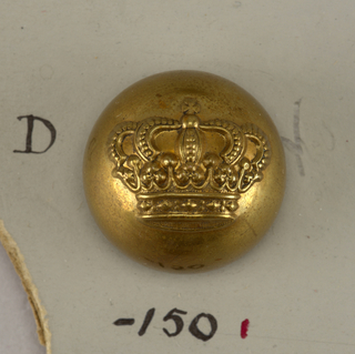 "Convex button ornamented with a crown. Back and shank of brass. ""A M and Cie Paris 21 M"" on reverse.""  On card E"