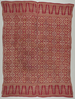 "Border at each end about 30 cm (9"") high with geometric flowering plants within a triangle motif (""tumpal""). Field contains an all-over floral diamond pattern. Originally a gold and silver pattern on red ground (metal no longer remaining). Two pieces sewn together with running stitch--each piece with loomed width of about 61 cm (24"")."