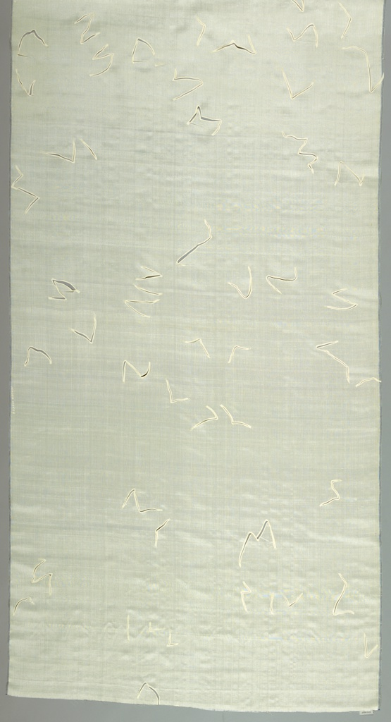 Undyed silk printed with zig-zag lines and cut to create flaps.