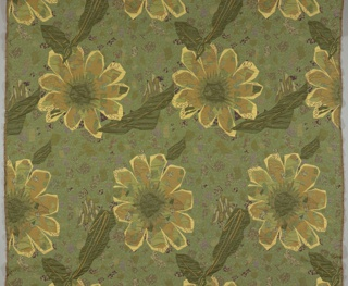 On a gray patterned ground of stone-like finish, jagged blossoms in brown and green as though cut from a different fabric with black leaves.