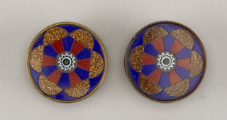 Button in design of six-spoked wheel ornament (red glass and goldstone on blue  ground); brass collet; tin back; copper shank.