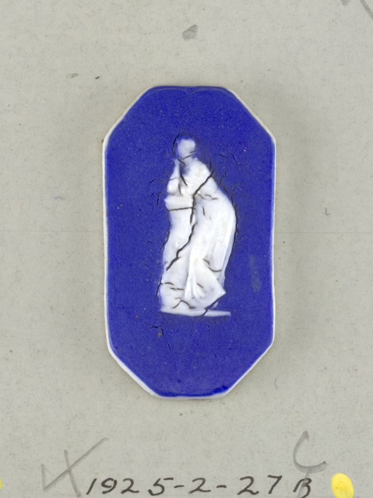 Three octagonal mounts in the style of Wedgwood Jasperware; A, B) ornamented with a nude figure; C) with a draped figure leaning on a pedestal; white on blue ground.  On card 4