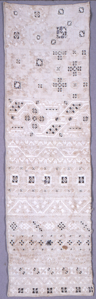 Vertical rectangle with twelve bands of white on white embroidery, including cut work with needle-made fillings.  The bands are variations of floral vines.