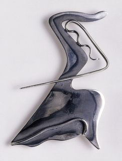 Brooch in the form of an abstracted dancer.