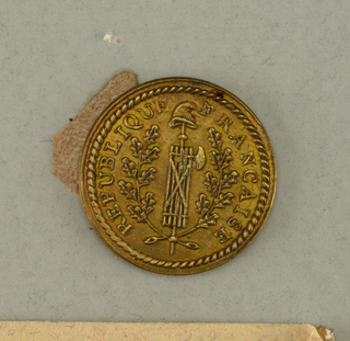 "Flat button showing fasces with axe topped by Liberty cap, placed against oak branches, surrounded by ""Republique Francaise""  On card B"