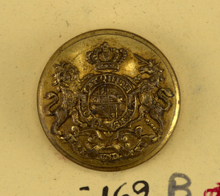 "Button showing coat of arms: heraldic devices surrounded by a band with ""Honi soit qui mal y pense"", lion and unicorn supporters, crown above and below, ribbon with ""Treu und fest."" Brass back and shank. On reverse, ""Firmin and Son 153 Strand, London.""  On card C"