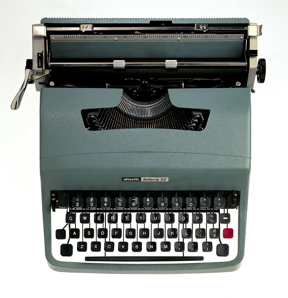 """A green/grey metal cased typewriter with a white keypad and black keys. """"olivetti"""" and """"lettera 32"""" in black and white on front of typewriter."""