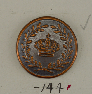 Button ornamented in design of a crown within crossed laurel sprays. Brass back. Copper shank.  On card E