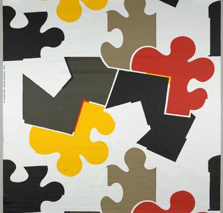 "Large ""puzzle pieces"" in black, yellow, red, dark grey and khaki on a whiteground."