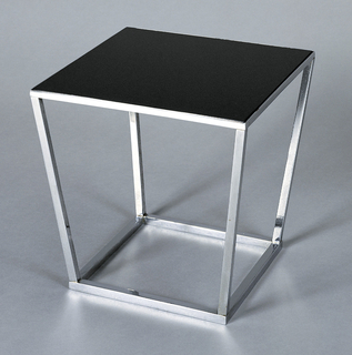 Square glossy black vitrolite top inset into tapering rectilinear chrome-plated metal frame base.