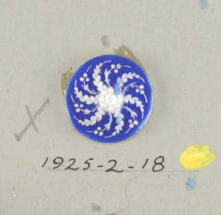 Circular medallion in the style of Wedgwood Jasperware; open flower swirled leaf ornament; white on blue ground.