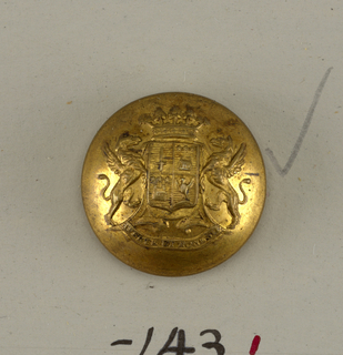"Circular, convex button with ornament showing shield with heraldic devices, griffin supporters, a crown above and below, ribbon with ""Aperte et honeste"". Brass back and shank. On reverse, ""Superieur France"".  On card E"