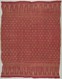 "Sarong with a border (about 29.8 cm (11 3/4"") high) at each end showing ""tumpal"" motif (row of isosceles triangles). Field shows small plant forms within a diamond lattice. Originally gold and silver pattern on a red background (metal no longer remaining). Two pieces sewn together with running stitch--each with loomed width of about 63 cm (24 3/4"")."