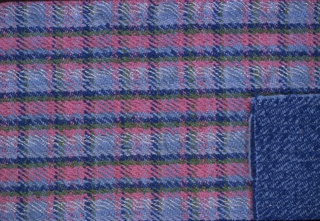 Plaid of bright blue, green and pink on ground of pale blue. Some weft stripes have threads wound with thin gold strips. There is an attached sample of plain twill in light and dark blue.