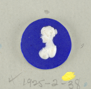 Circular medallion in the style of Wedgwood Jasperware; ornamented with bust in classic manner; white on blue ground.
