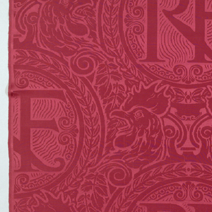 "Deep red damask with large medallions encircled by a laurel wreath and enclosing the initials ""RF."" Between medallions are paired French rooster heads. Designed for the French embassies."