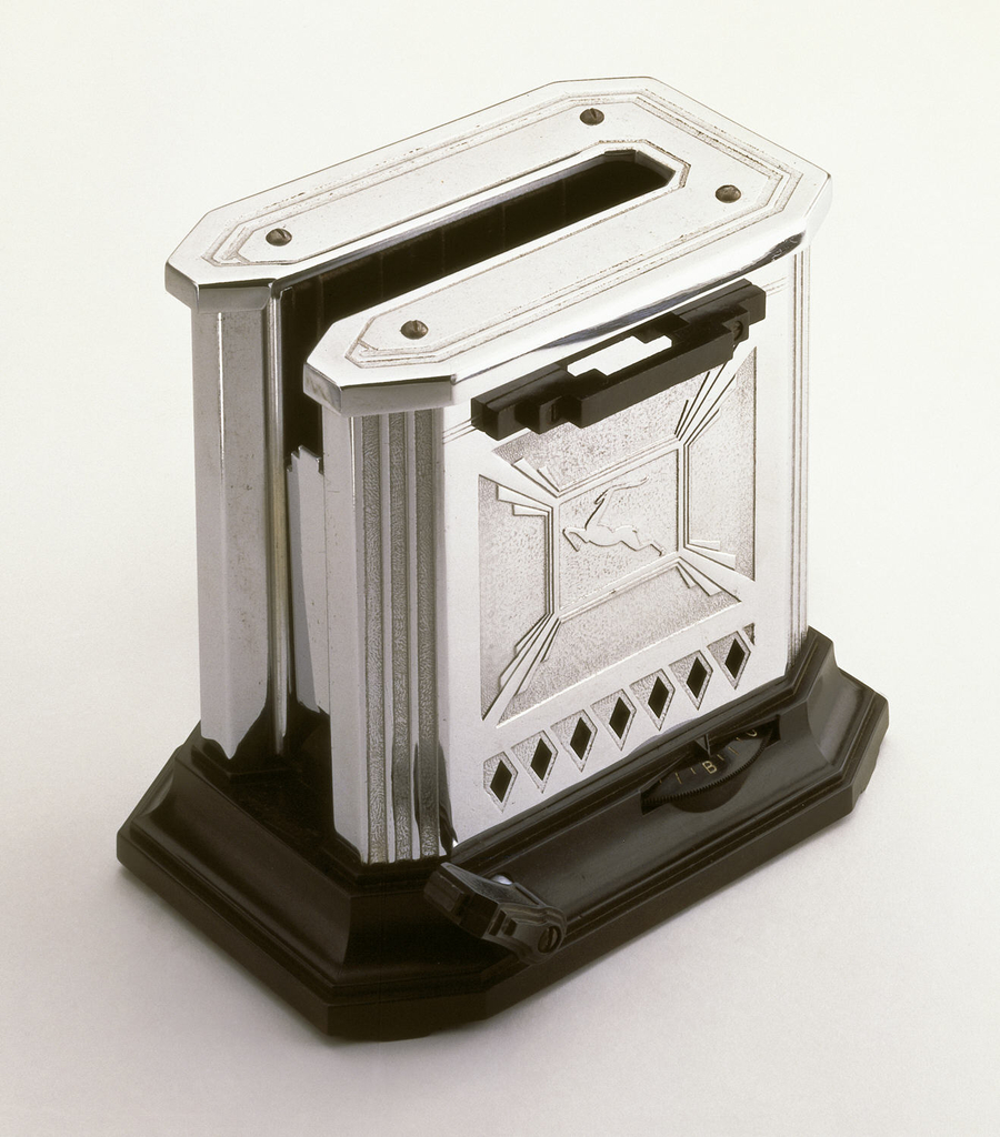 A square metal toaster and black rectangle base both with rounded corners. Opening on the top for toasting.