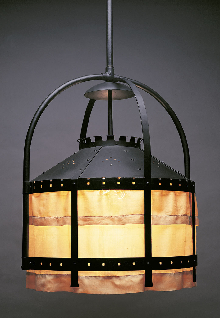 Circular hanging lamp with iron frame and dome top. Hanging from the dome are rectangle panels of silk, lit from within.