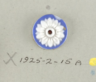 Circular medallion in the style of Wedgwood Jasperware; each showing an open flower with ten petals and rays.  On card 4