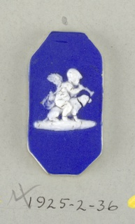 Octagonal mount in the style of Wedgwood Jasperware; ornament shows a cupid, on a dog, blowing a trumpet; white on blue ground  On card 4