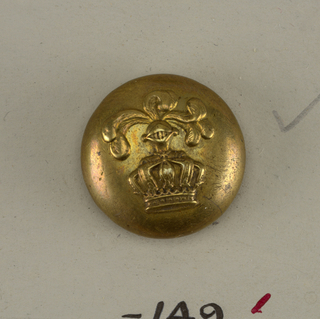 Convex button with ornament in design of a crown with helmet and feathers.  On card E