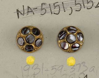 circular, convex brass buttons; each button ornamented with six discs of banded agate; brass shanks.