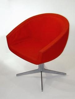 """Various prototypes and objects from Don Wallance Archive, including: One protype chair consisting of bucket-type seat on metal shaft with four splayed feet; covered in red woven fabric; one prototype of a folding chair(?) (""""LLL""""): flat plywood seat and back mounted on bent tubular metal frame, hinged under seat; two chair elements: one roughly triangular metal chair-frame part(?) with oval tubular metal brace near apex (""""MMM""""); one roughly U-shaped tubular metal chair-frame part(?) (""""NNN"""").  Cutlery, tableware and other prototypes."""