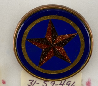 Buttons in design of five-pointed star ornament (red glass and goldstone on blue  ground); brass collet; tin back; copper shank.