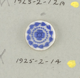 Circular medallion in the style of Wedgwood Jasperware; showing open flower (four petals) surrounded by ring of dots and ring of bell flowers; blue on white.  On card 4