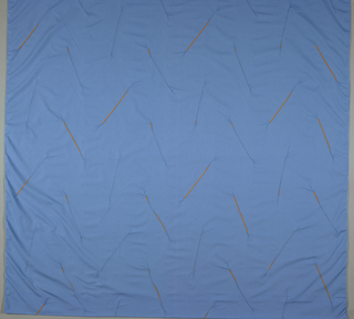 blue fabric with diagonal orange lines which are pleated and machine sewn