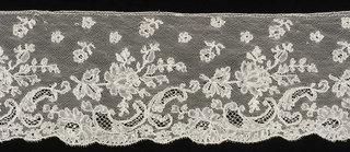 Pattern shows rose spray and cartouche forms with scalloped outer edge.