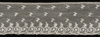 Border of Mechlin lace has the upper part ornamented with buds in diagonal rows. At the border, a row of scrolls with flowers and leaves. Edge is straight.