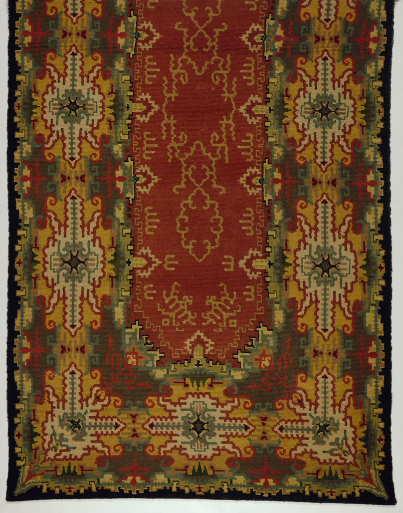 Commercially-woven carpet showing the influence of Amsterdam School designs on popular taste in the 1920s.