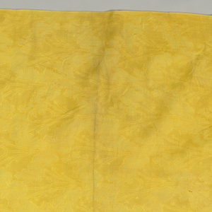 Monochrome continuous pattern of closely spaced vertical vines with leaves and blossoms. In recent years, this panel has been piece-dyed yellow.
