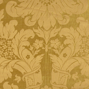 Design in orange of flowers, cornucopias and leaves on a bright yellow background.
