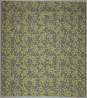 Ribbed textile with an allover design of six-petal blossoms and leaves of contrasting color.