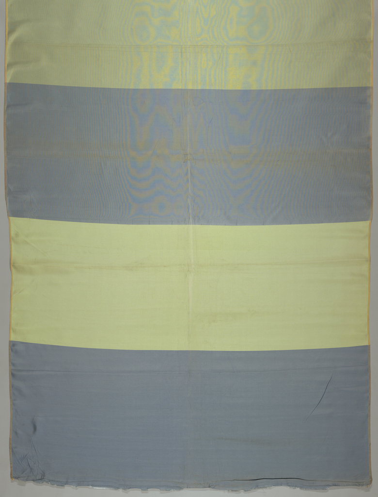 Length of fabric demonstrating three basic weave structures: plain weave, twill and satin. There is a change of weft threads from blue to yellow in each section.