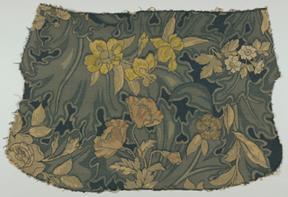 Upholstery material from the back of a large chair. Incomplete repeat of large-scale naturalistic flowers like poppies, iris and other blossoms in a cream color shaded with dull red and rose. Background in shades of green.