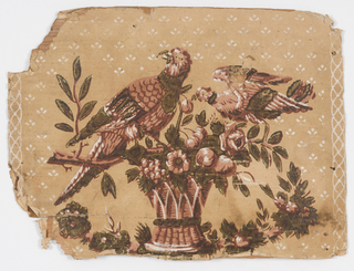On light brown background with scattered white fill of simplified petals, large central pattern of two birds perched on basket of flowers and leaves. Printed in pinks, green and white. Vertical borders of white interweaving lines.