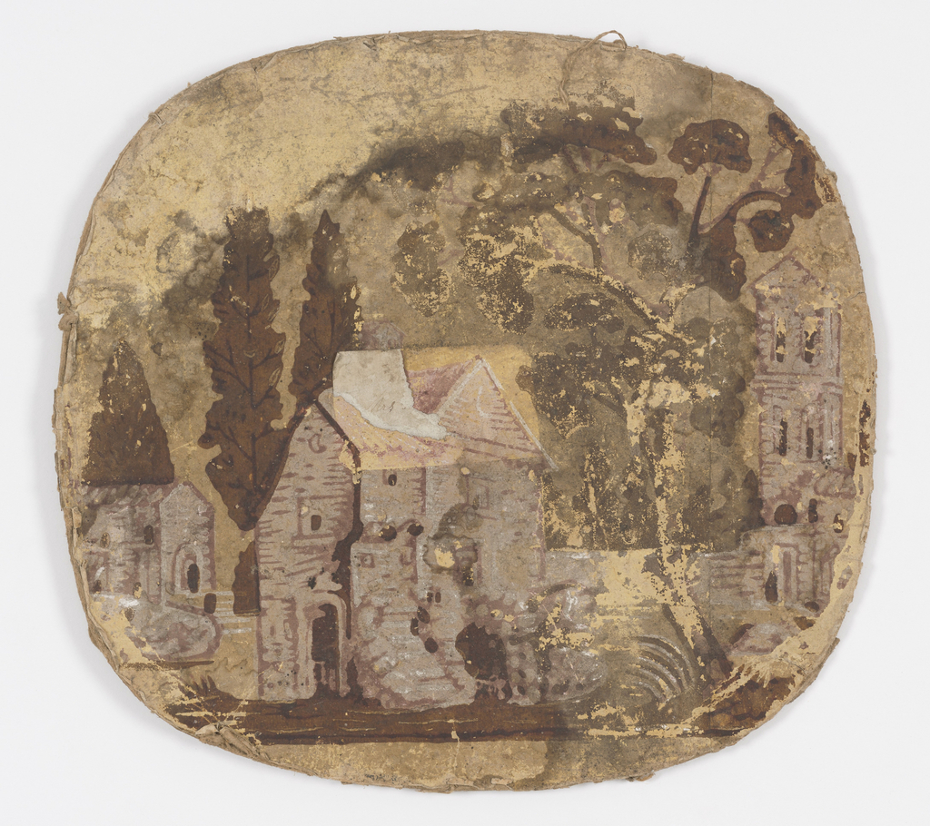 """Pasteboard bandbox lid, rim missing. """"Castles in Spain"""" pattern. Buildings and trees are printed in pink and browns on yellow background. The lid is small, only the central portion of complete pattern shown."""