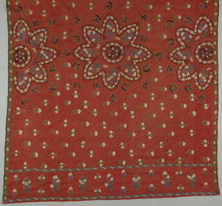 Hindu-type embroidered shawl with an eight-pointed star centered in a panel that has one half of the star repeated at both sides. In between are small birds. Flowering trees fill space above and below medallions. Both ends have twenty-one centimeter wide border of flowering trees set at a ninety-degree angle to the field as if growing from both ends. A narrow floral border is on both sides. Shawl is made from two pieces stitch together; one is very narrow.
