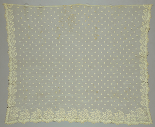 Bonnet veil of embroidered net with a floral border on three sides with the widest border at the bottom edge. Border has a pattern of flower clusters and leaves with small flower heads scattered across the field.