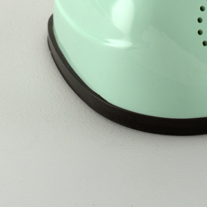 Light blue one-piece unit; ear piece tapering down to flaired rounded base/mouthpiece; rotary dial/on-off switch on underside of base.  Grey cord attached at back.